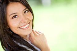 Portrait of a beautiful Latin woman smiling outdoors