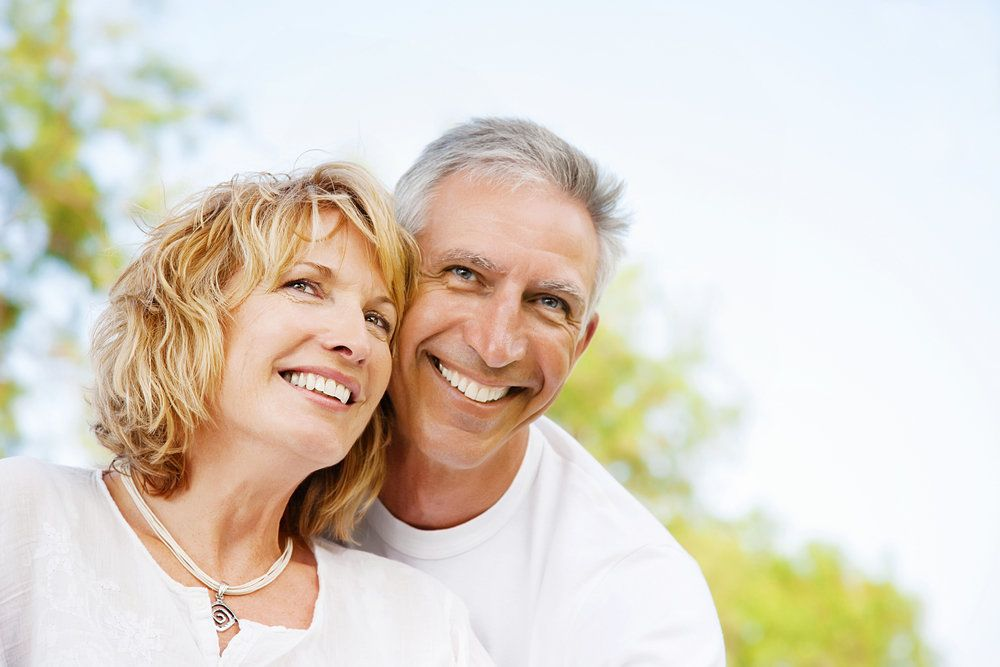 Older couple smiling and looking up