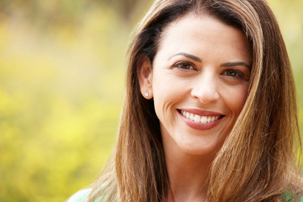 Smiling woman with long brown hair and highlights