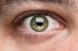 Close-up of man's green, healthy eye