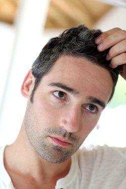 A man examining his newly transplanted hair