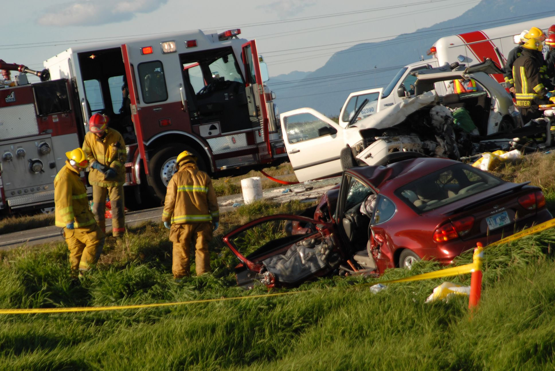 Firefighters responding to an auto accident on a rural road