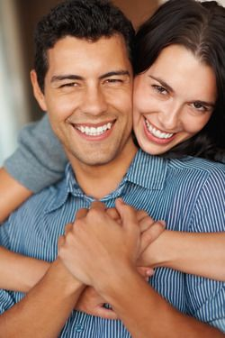 Smiling, laughing couple with very straight, white teeth