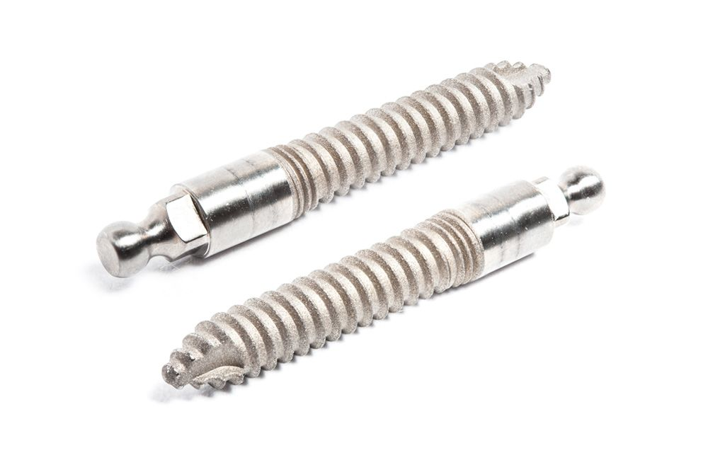 up close photograph of mini titanium dental implants