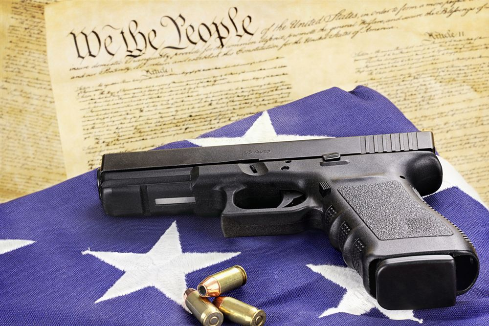 A gun and the American flag