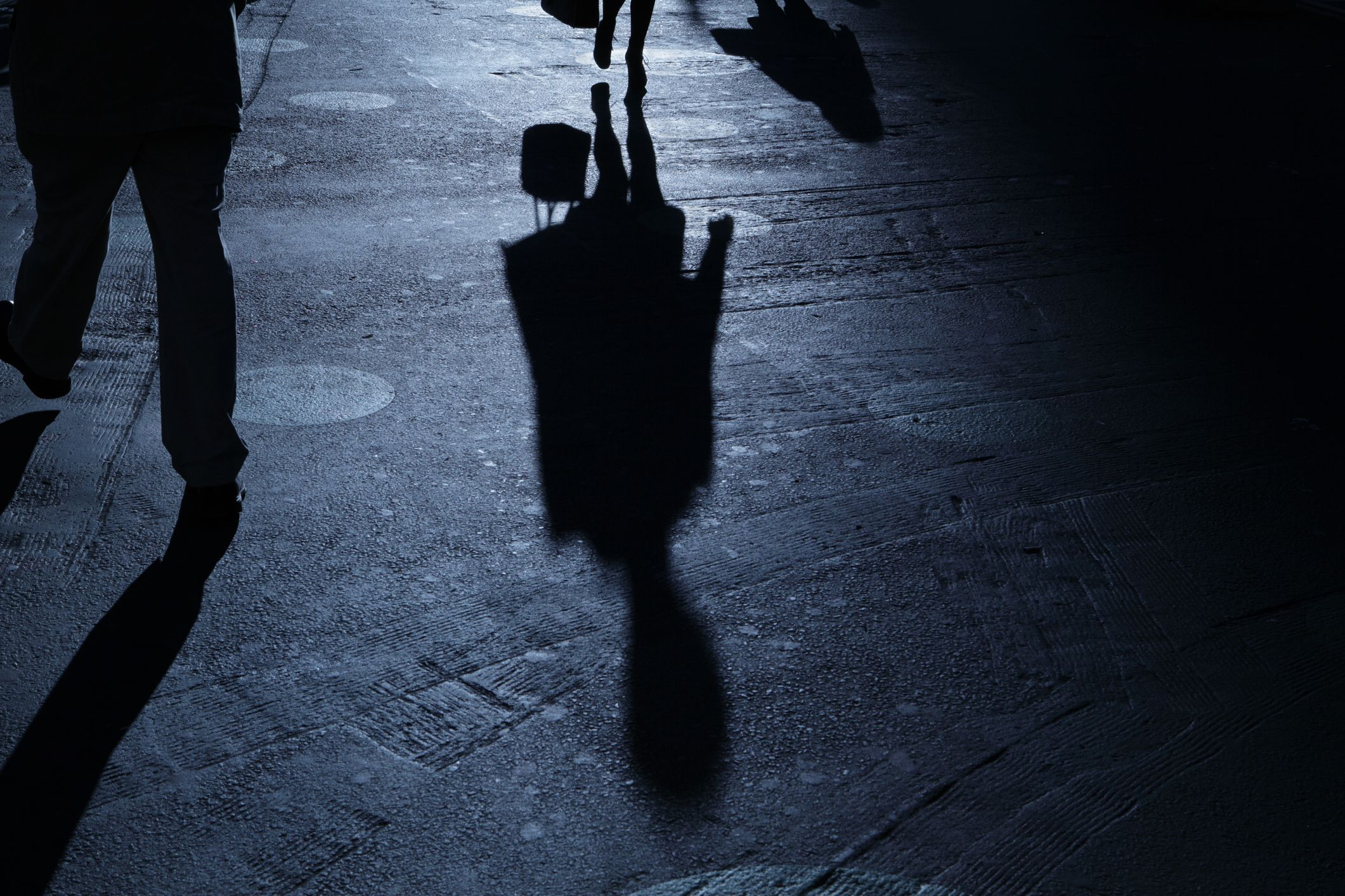 person walking alone at night