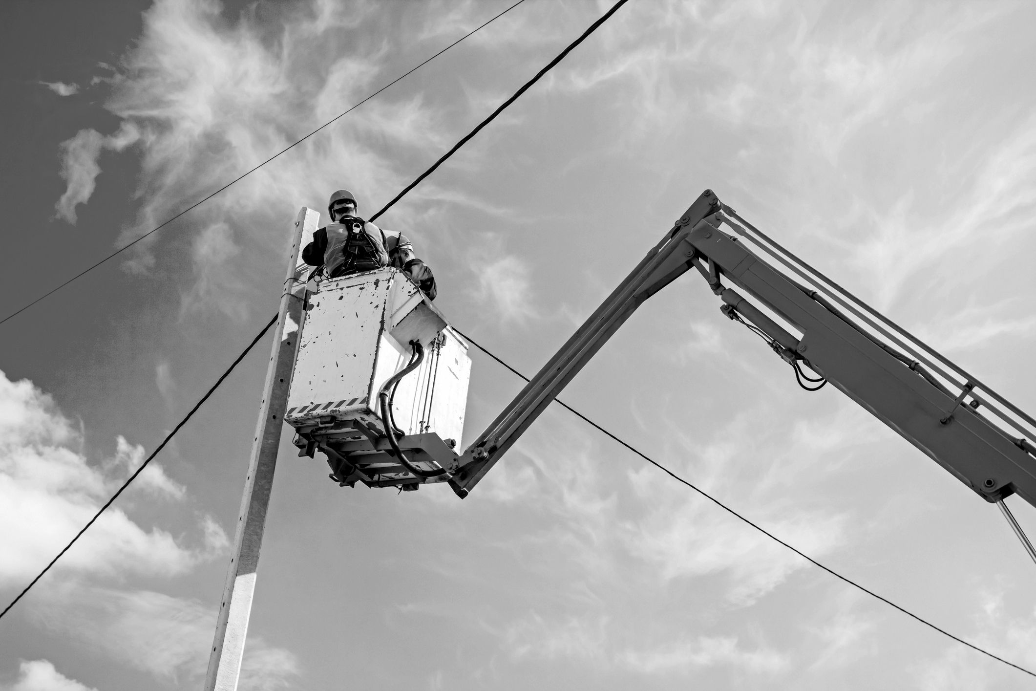 Working on powerlines in a cherry picker