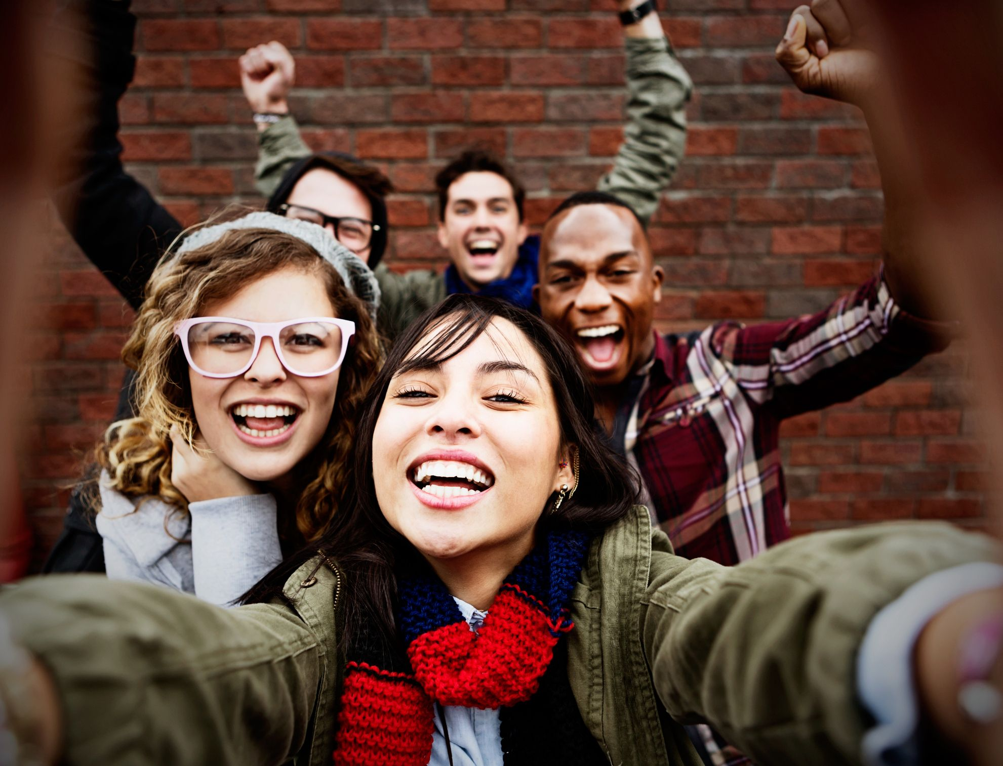 Group of smiling teens taking a selfie