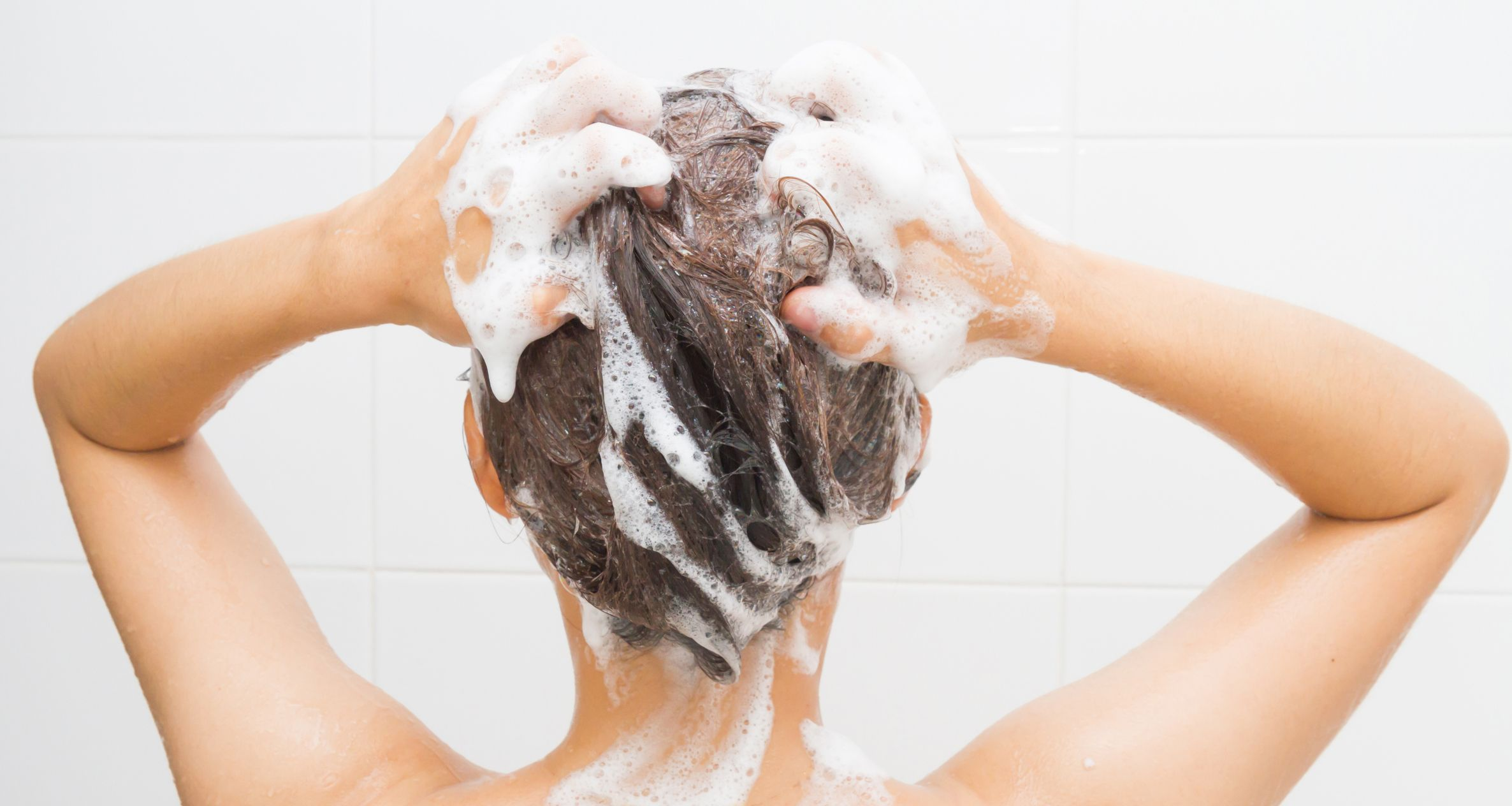 A woman washing her hair