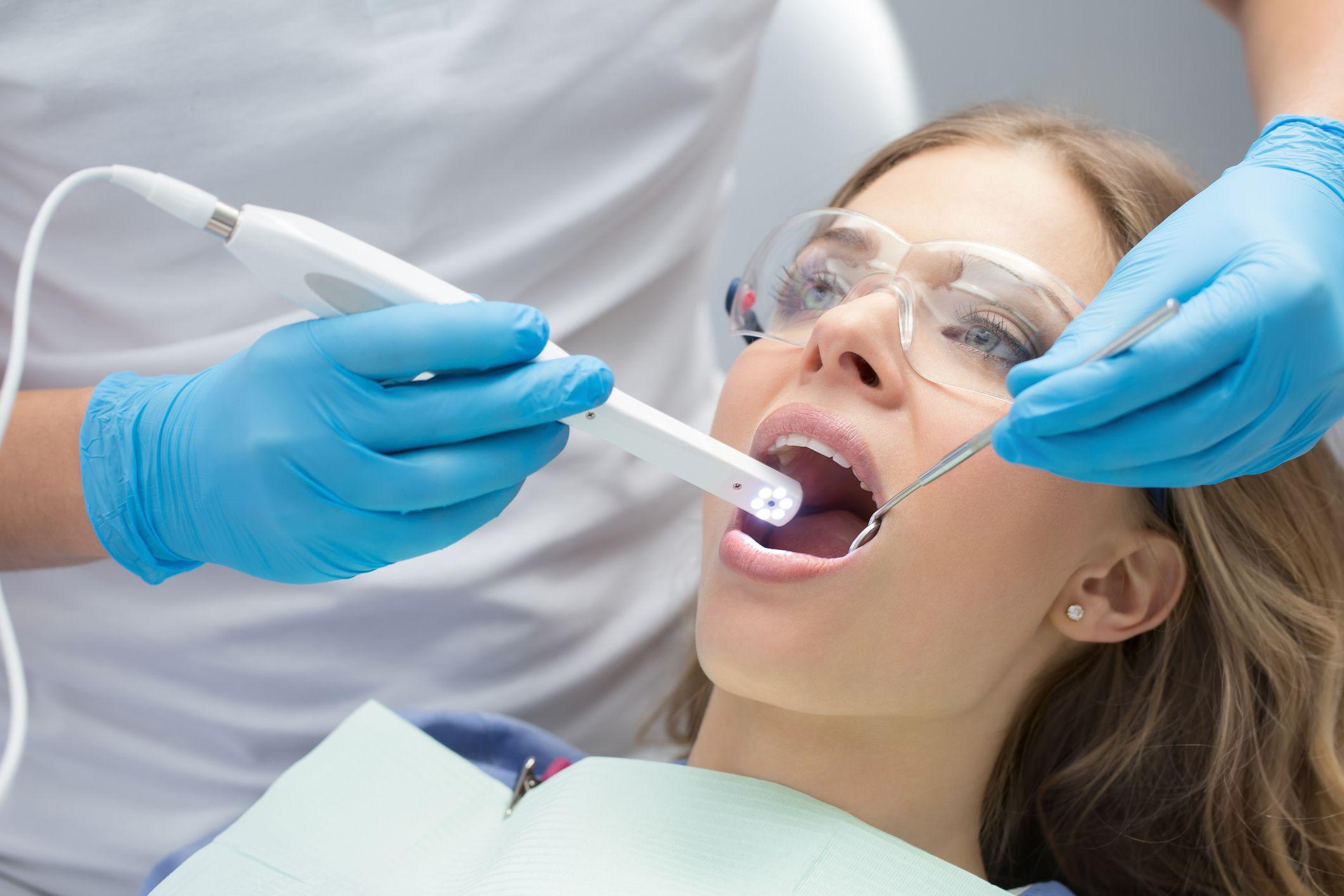 A woman undergoing dental bonding