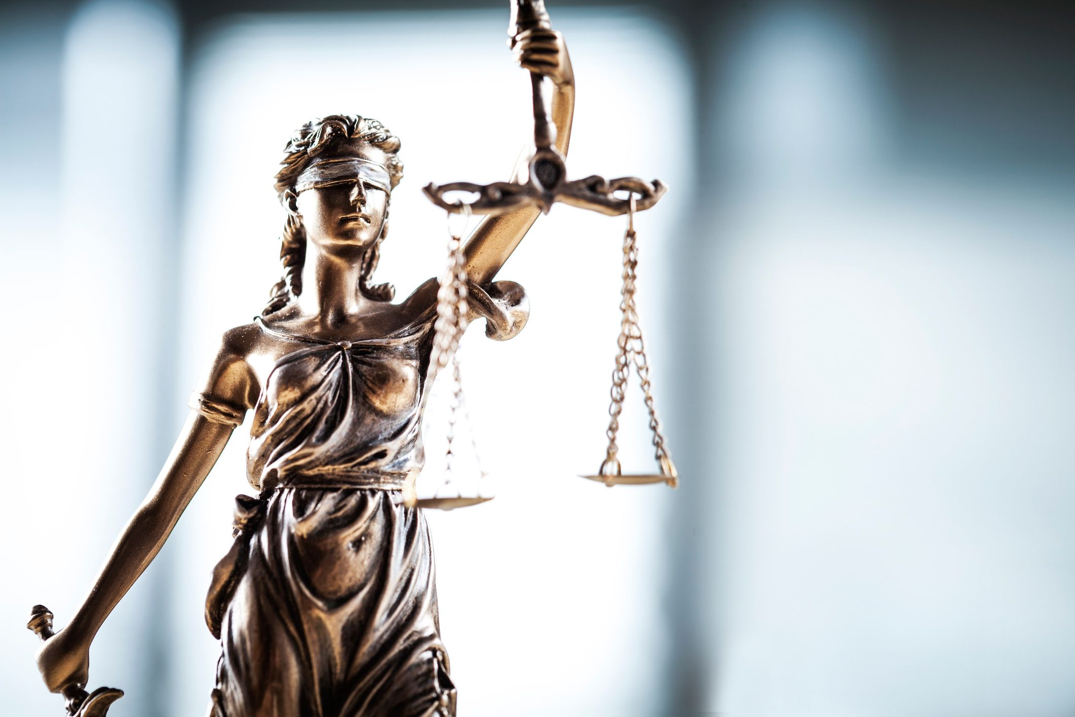 Lady justice with legal scales