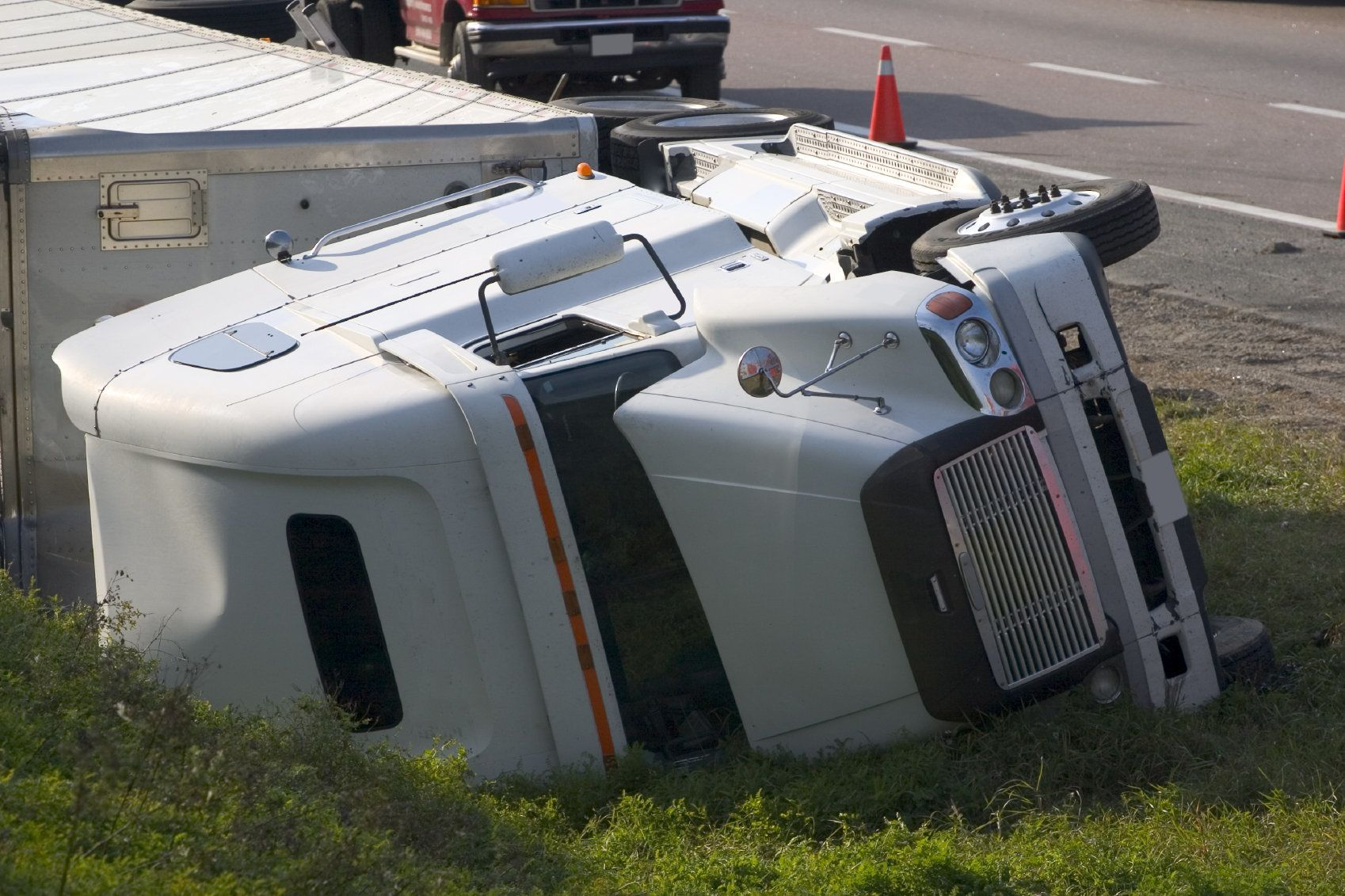 An overturned 18-wheeler truck after a rollover accident