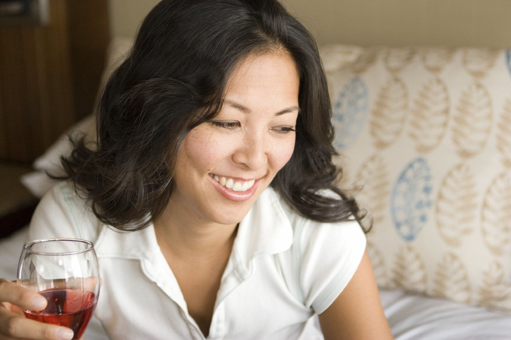 A woman having a glass of wine