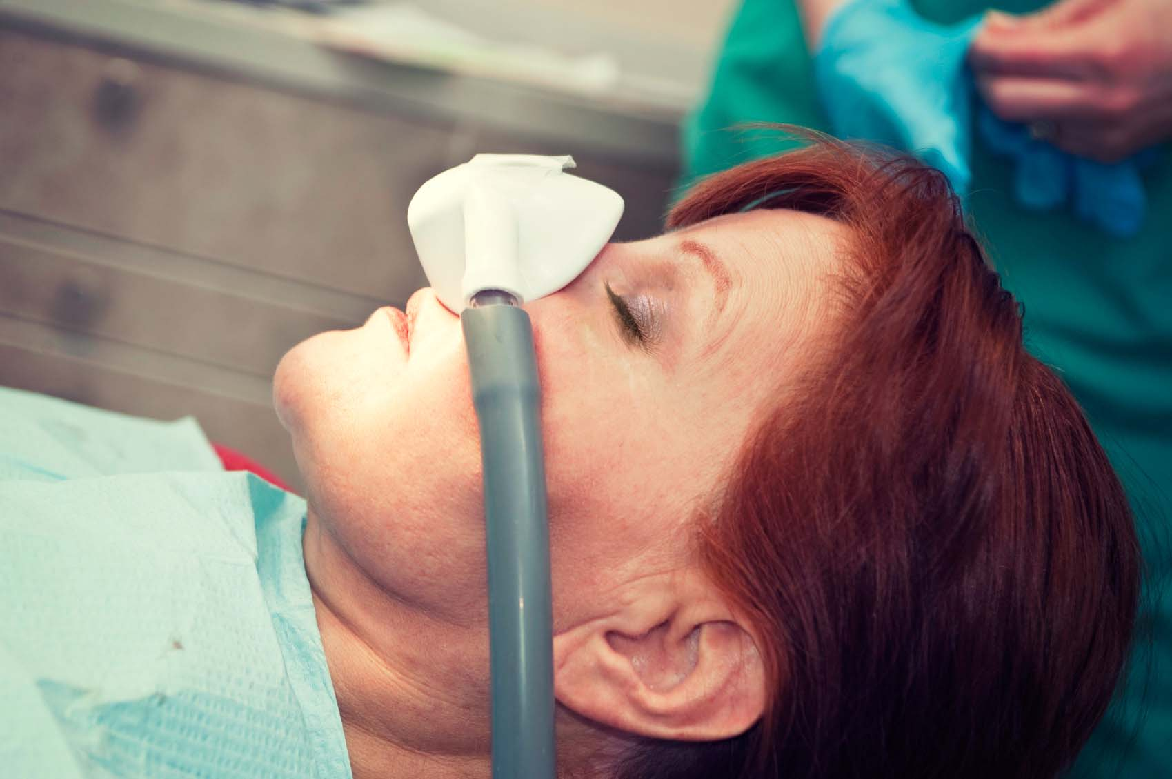 A woman undergoing dental sedation