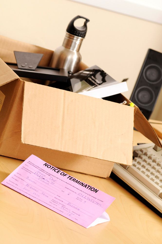 A pink slip and a box of stuff after workplace termination
