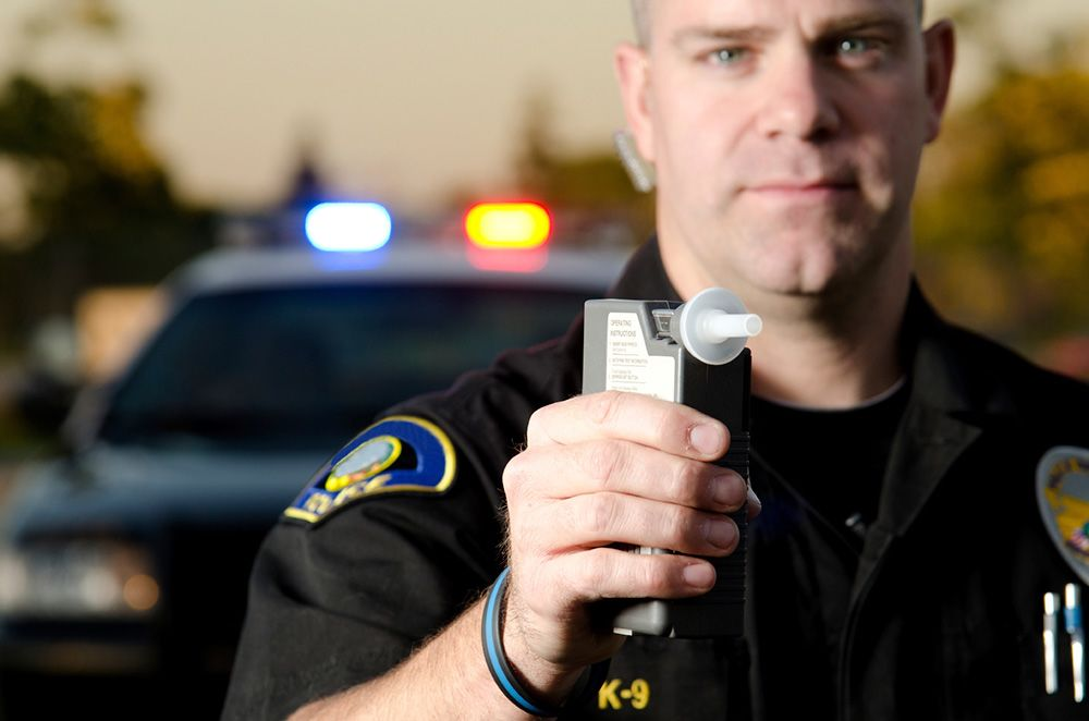 A police officer with a breathalyzer test