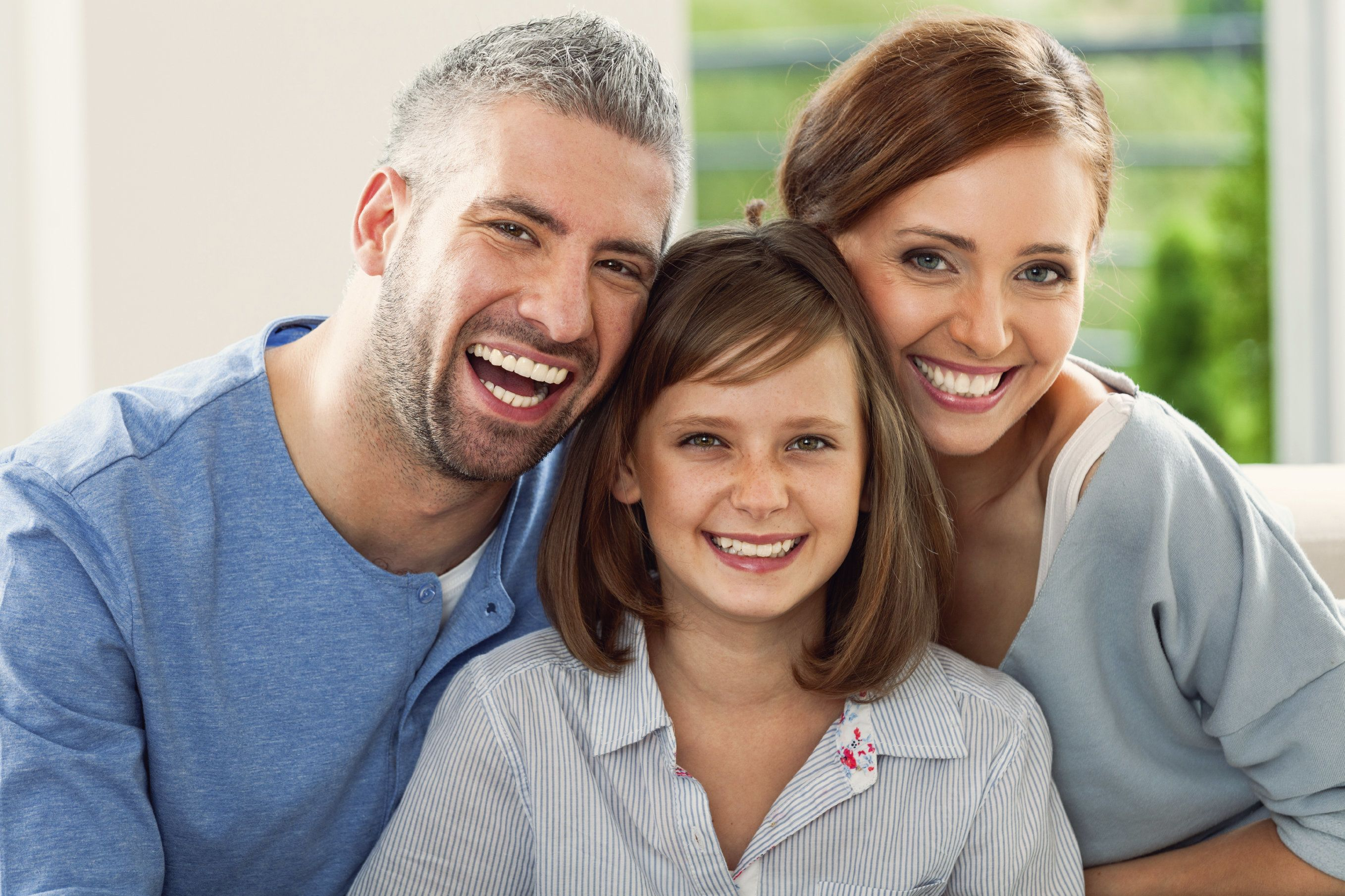 Smiling parents with young girl