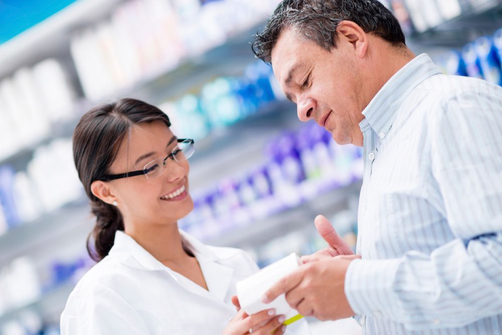 Customer speaking with a pharmacist