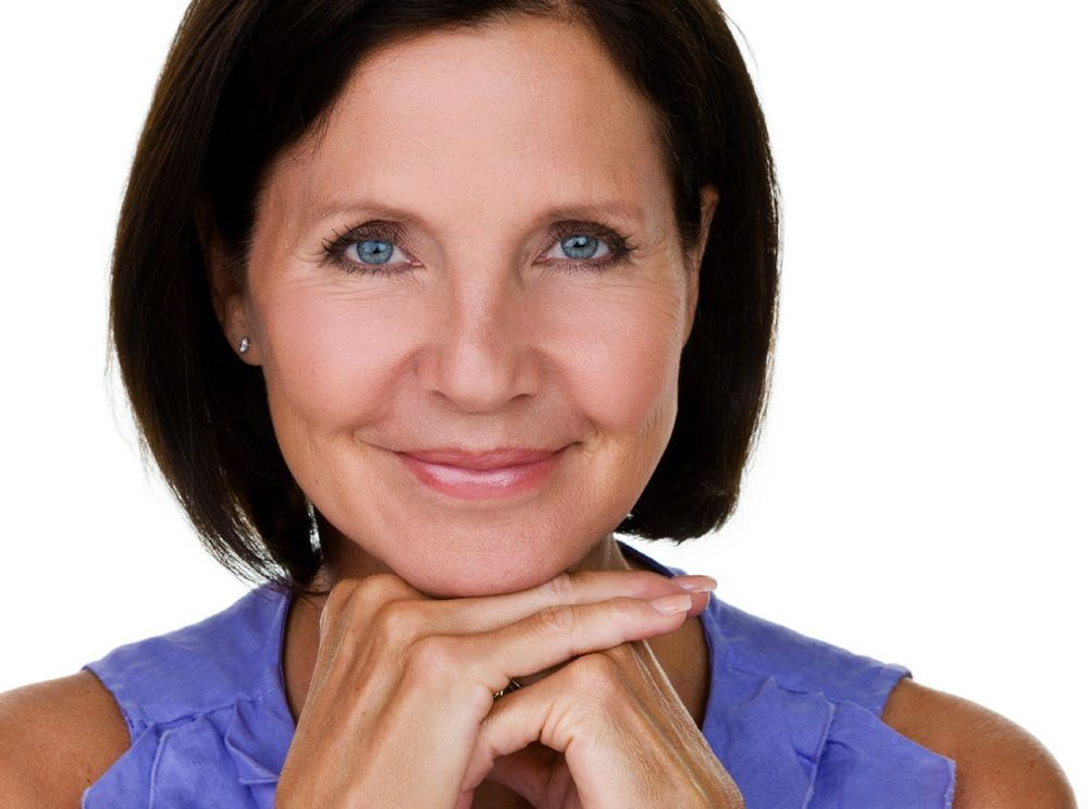 Woman with beginning signs of aging around the eyes