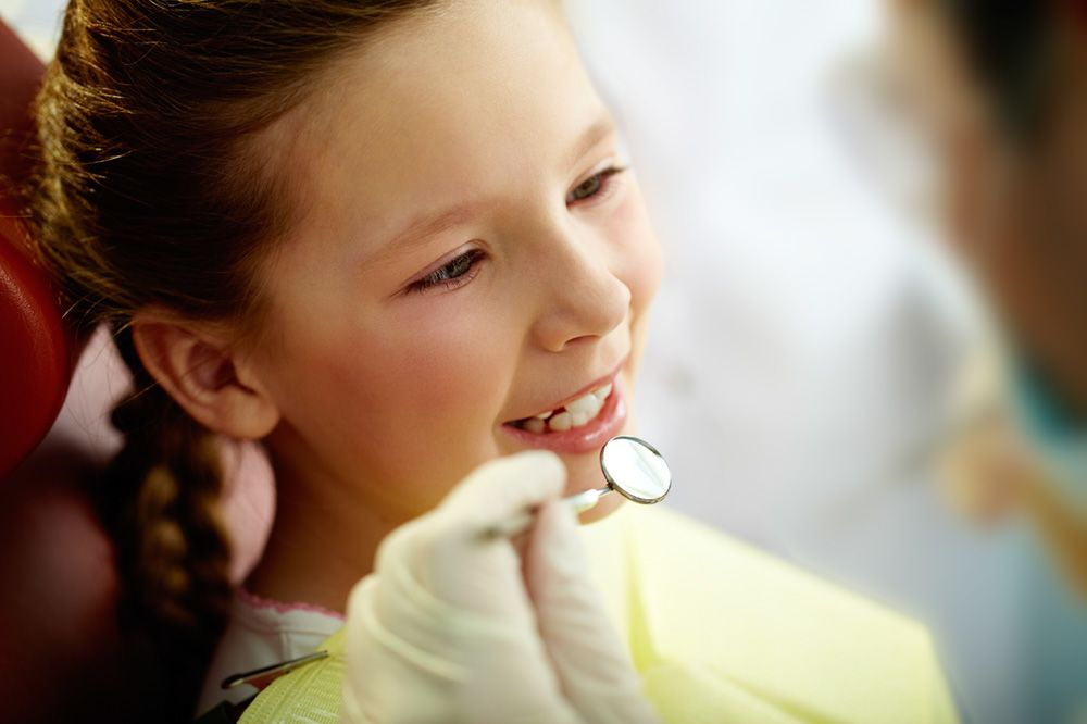 A child undergoing a dental exam