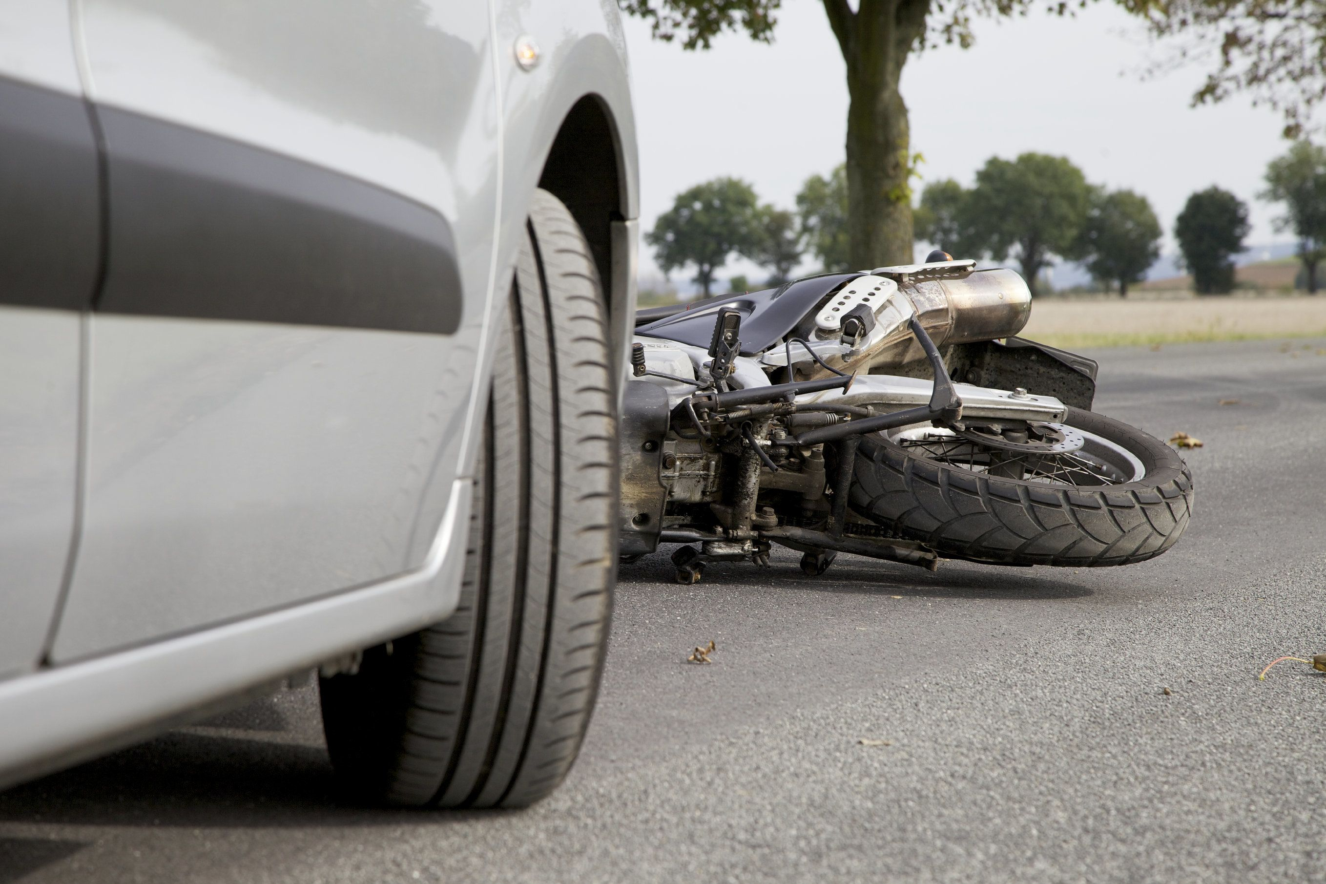 A motorcycle on the ground after an accident