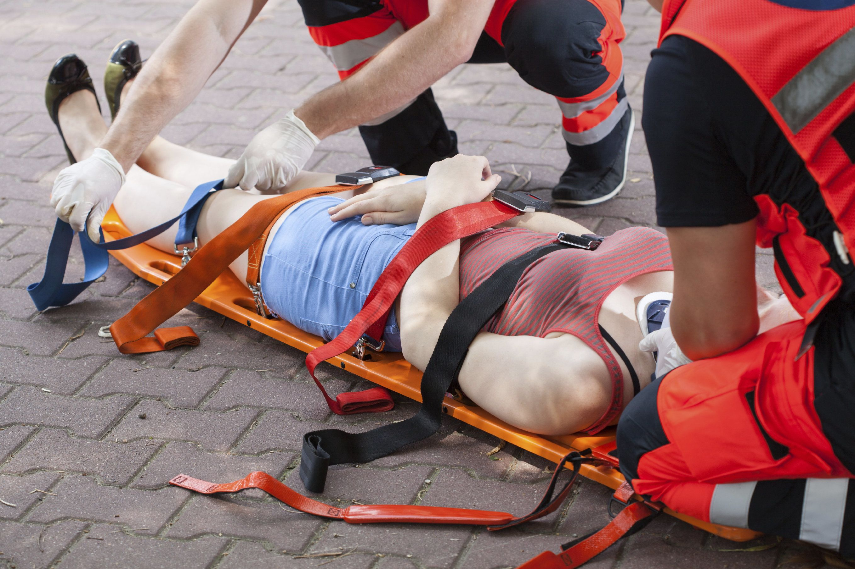 A spinal cord injury victim being placed on a stretcher