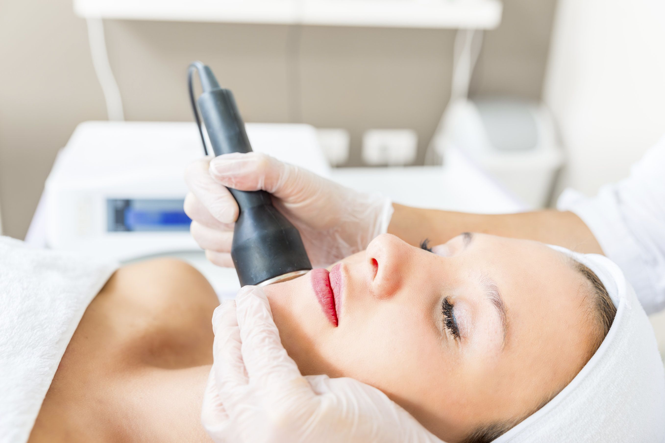 Woman receiving laser facial treatment