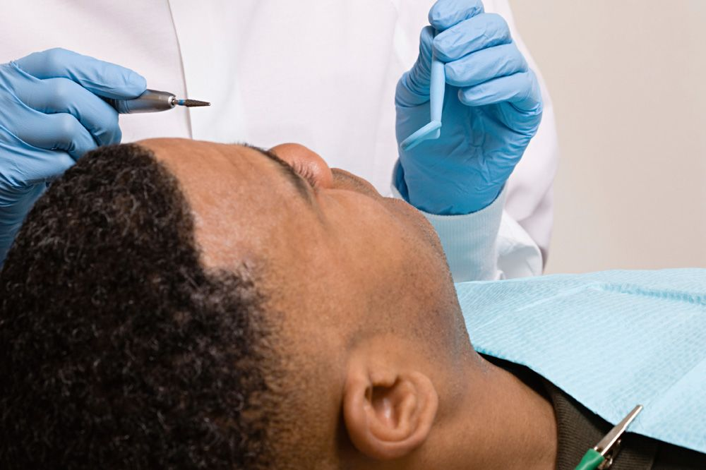 A man undergoing dental treatment