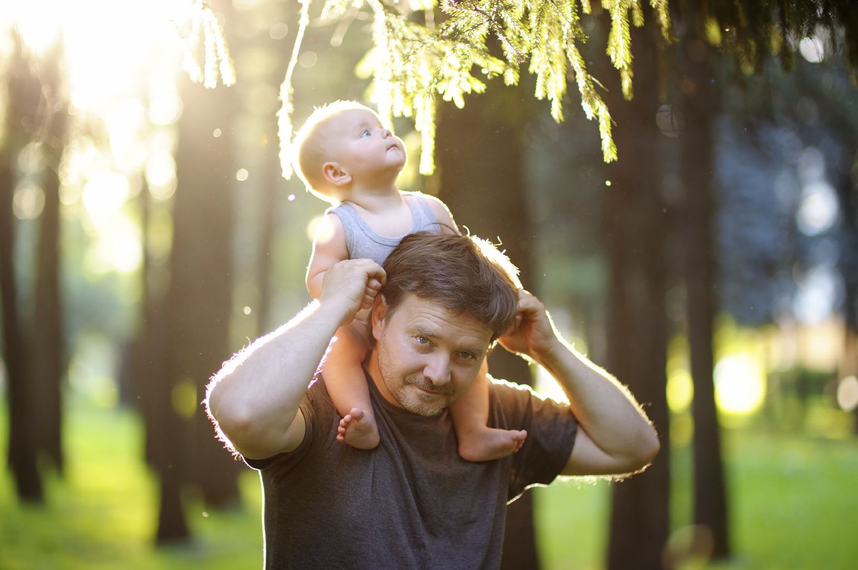 Image of man with baby on his shoulders