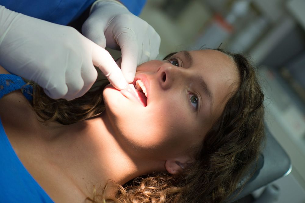 Female patient undergoing oral cancer screening