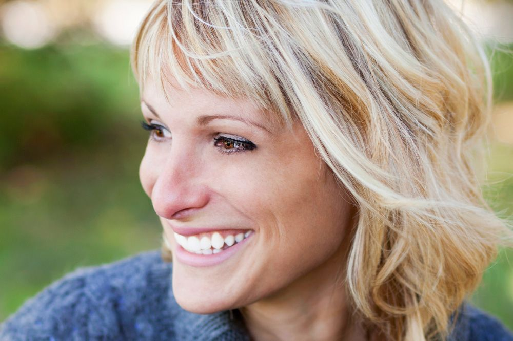 A smiling blonde woman
