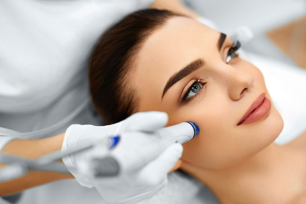 Woman receiving microdermabrasion treatment