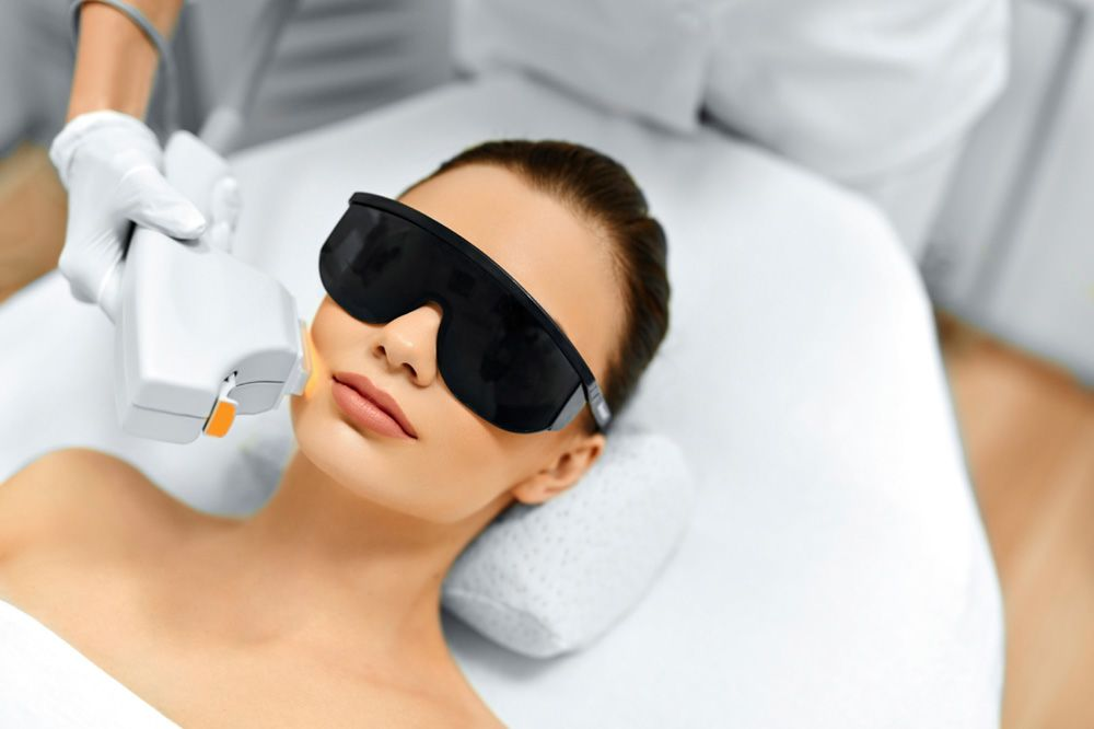 A woman undergoing laser skin resurfacing