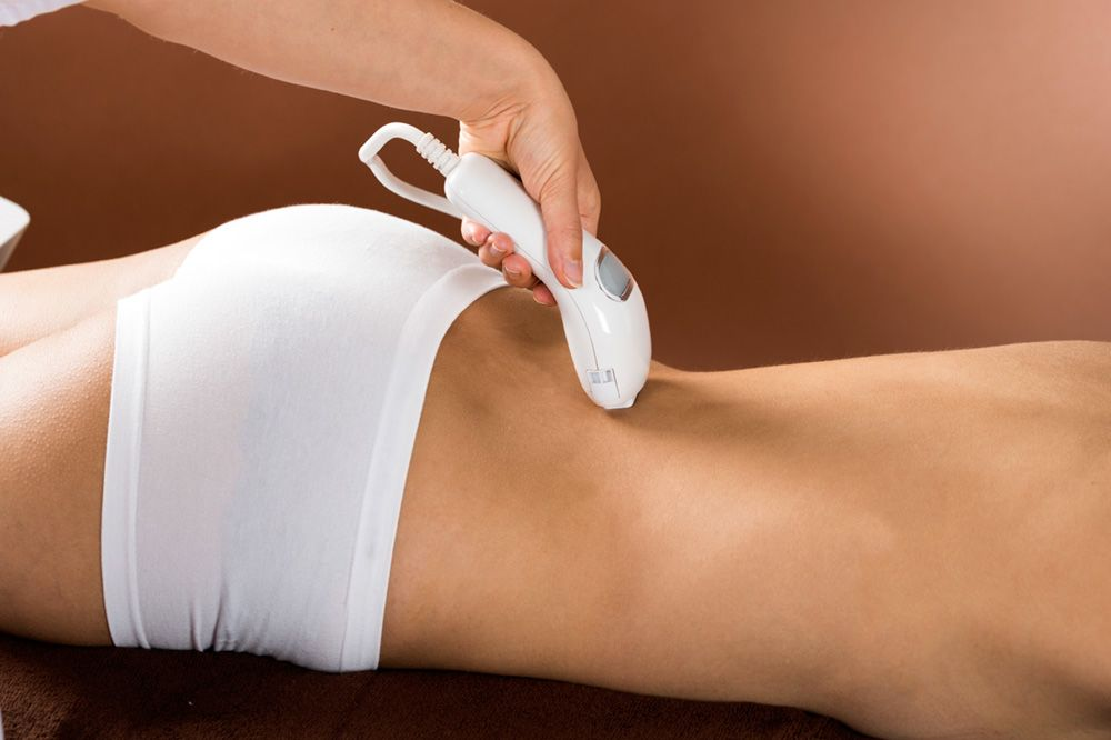 A woman's lower back undergoing treatment