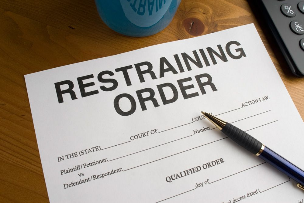 "Top of document reading: ""RESTRAINING ORDER."""