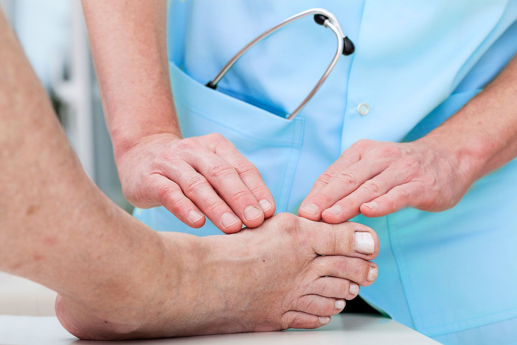 Doctor touching toe surgery patient's foot