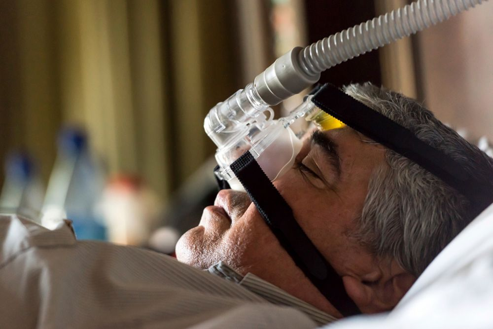 Patient wearing a CPAP device.