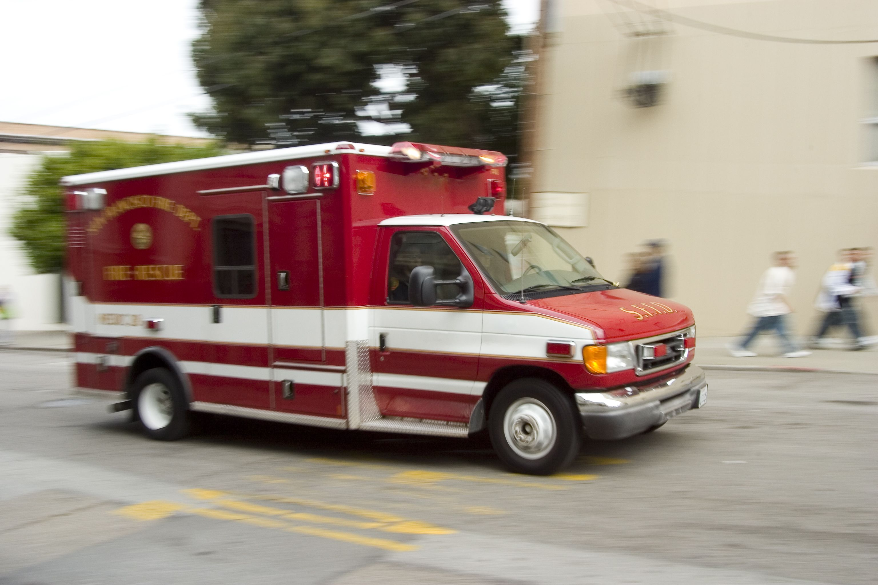 An ambulance, rushing to the scene of an accident