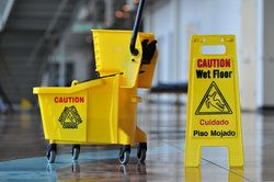 Caution - Wet Floor yellow sign.