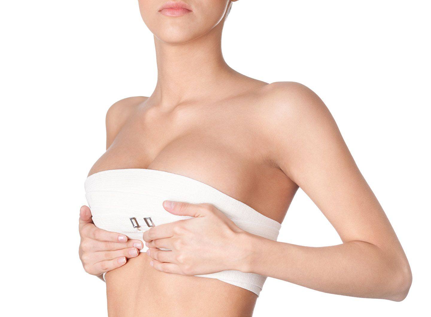 Woman wearing compression bandage around breasts.