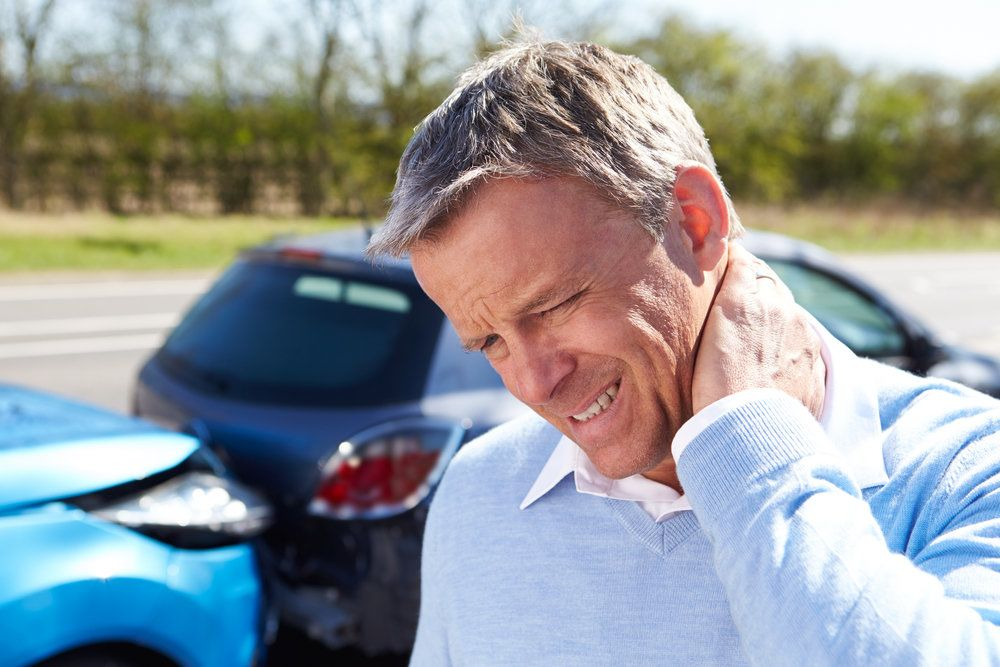 A man with a sore neck after an auto accident