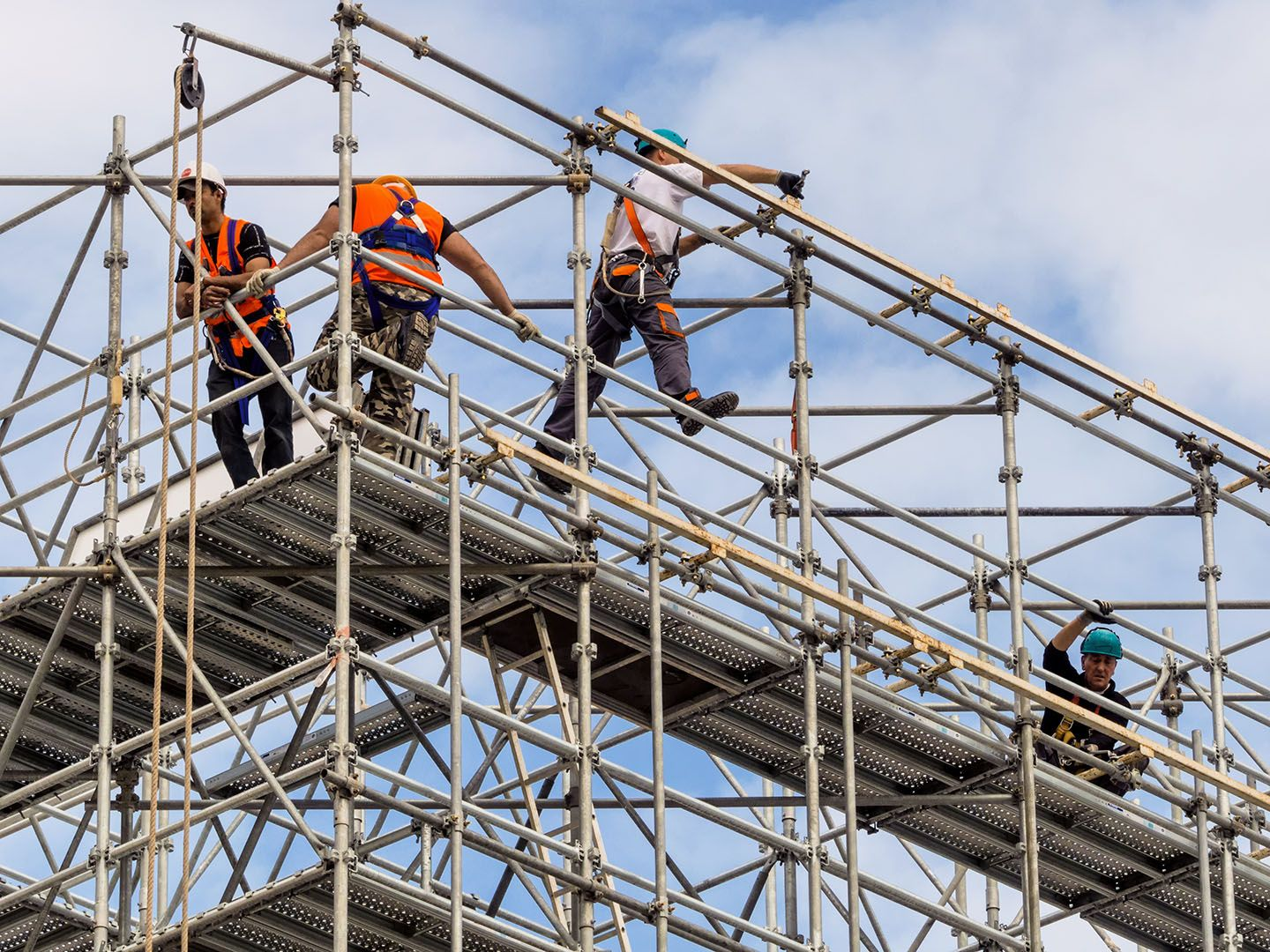 Construction workers on scaffolding