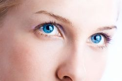 Close up of pale woman's bright blue eyes