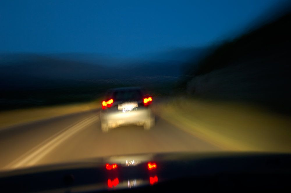 A blurry image of a car driving at night
