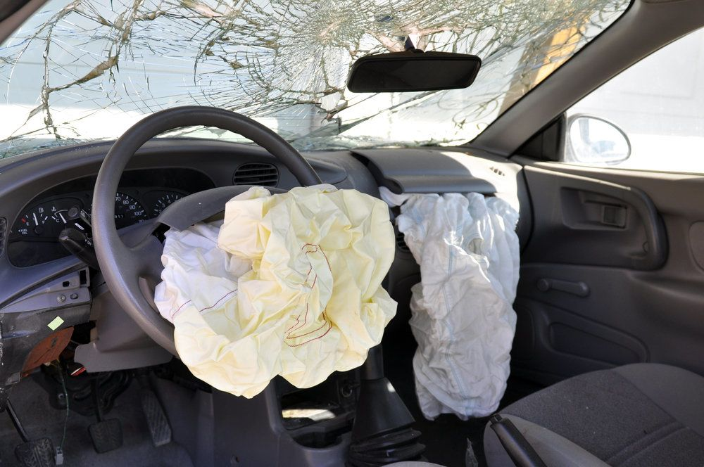 The aftermath of an auto accident with airbags deployed