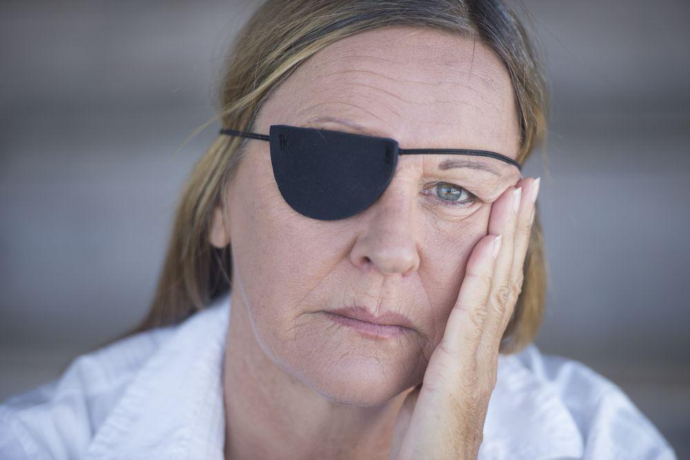 Older woman wearing eyepatch
