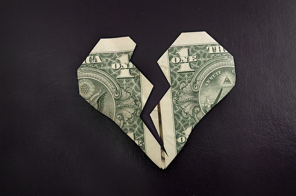 Origami dollars bills folded into broken heart