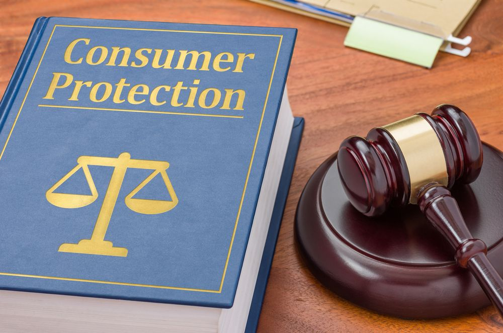 Consumer protection law book and gavel