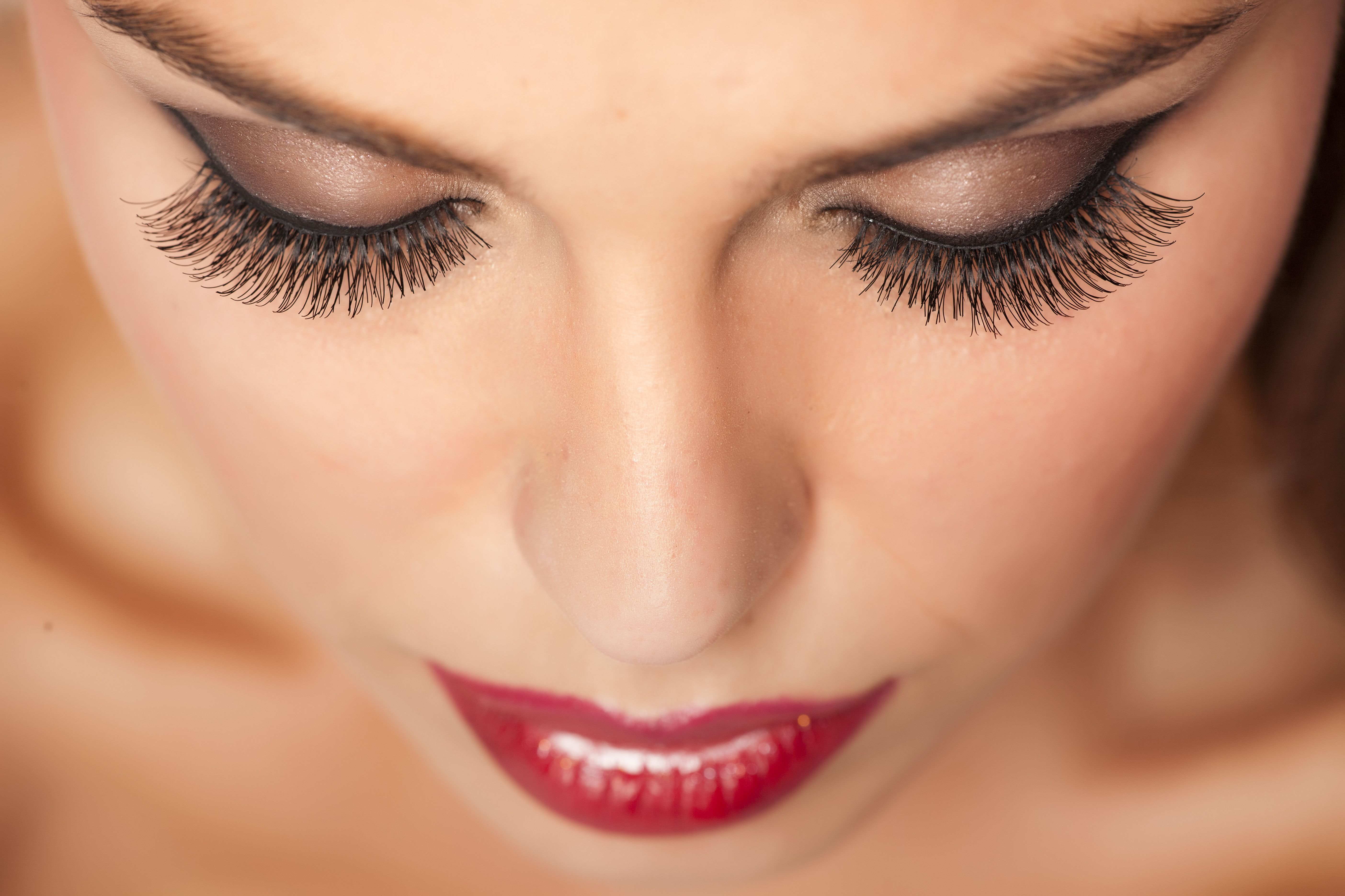 A woman with long, full eyelashes