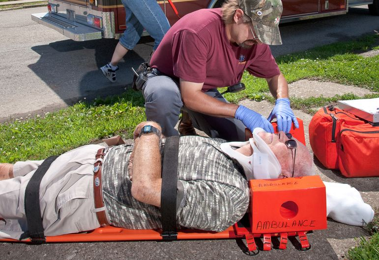 EMTs help an injury accident victim